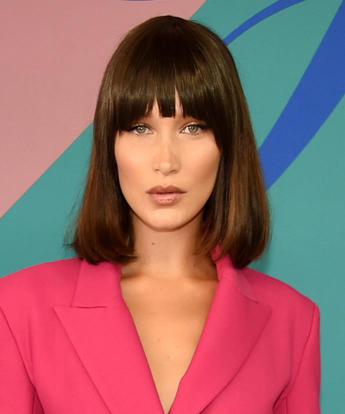 **Bella Hadid.** If you're working with a fringe, always blow-dry it first. If you leave it to air-dry, your bangs will set in their current position. Cue: cowlicks and gaps. If you want a sleek, straight fringe, blow-dry on a medium heat using a tail comb to keep your hair in check. For a slight volume hit, use a small bristle brush and direct the air downwards. **PRO TIP:** Don't use any product on your fringe—its close proximity to your T-zone means it can get greasy quickly, so it's best to avoid any oil-based serums or product.