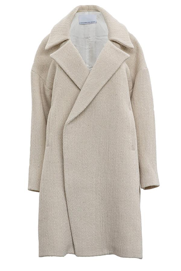 "**A Cardigan Coat:**  A relaxed shoulder shape will make you feel like you're wearing a big, warm hug all winter long. Coat, $435, Charlie May at [The Undone](https://www.theundone.com/collections/jackets/products/charlie-may-natural-cream-drop-shoulder-coat|target=""_blank""