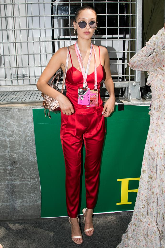 In a red silk jumpsuit the Monaco Formula 1 Grand Prix.