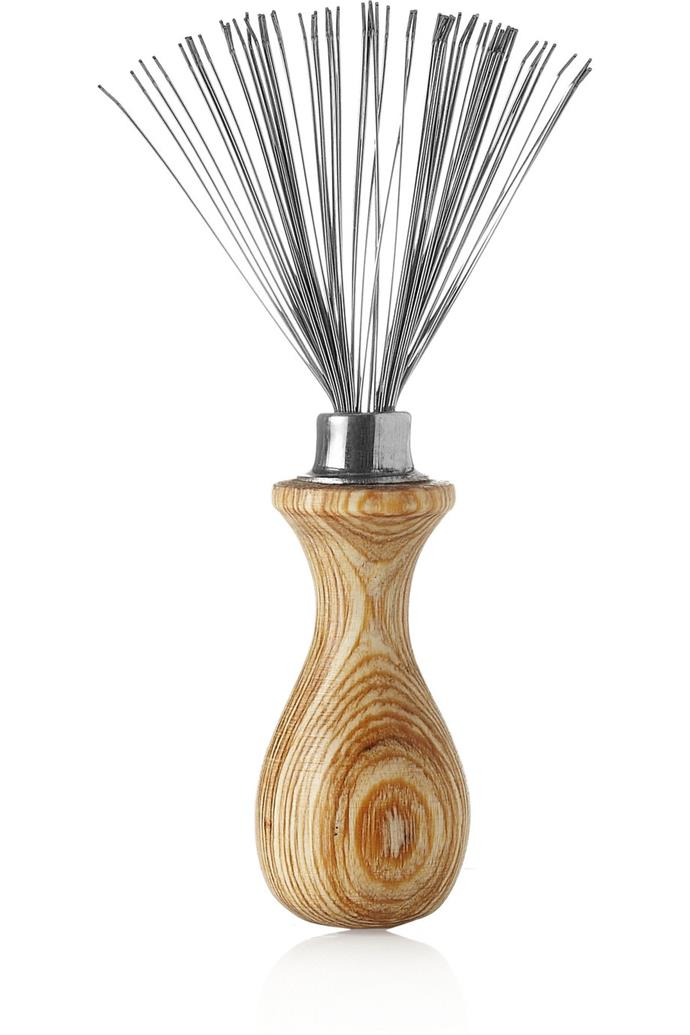 Philip B Hairbrush Cleaner, $31.32, at [Net-A-Porter](https://www.net-a-porter.com/au/en/product/337479/Philip_B/hairbrush-cleaner).