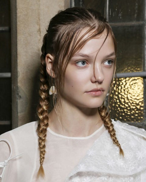 **THE BRAID UPDATE**  Plaits might not be anything new but this year it's all about leaving things loosey goosey.  'The fact that they are soft and slightly undone gives them an element of modern romance,' says Adam Reed, 'Not every hair is in place and it's not over clean and over tidy. The braid itself is the dominant feature of all of these looks.'  How to do it at home?  'Keep it soft with a bit of movement so it looks deliberately like you've done it yourself', says Adam, 'It's a good idea to use a hair oil to prep the hair so it looks healthy, glossy and shiny.'