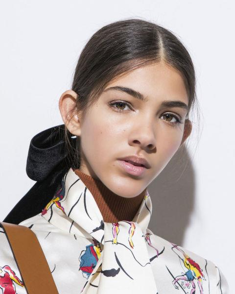 **RIBBON**  Working their way down the runway at Tory Burch and Marchesa, ribbons are officially back.  Why? According to hair stylist and owner of his eponymous salon, Paul Edmonds, it's because 'They're versatile and add a feminine touch to any occasion. I love the little black navy bow or ribbon loosely tied in a low pony tail which is slightly pulled away from the scalp. This can be worn either straight back with a classic centre parting or side parting for added glam.'  Anything we should avoid? 'Don't wear the big bow, it's a bad throw back!'