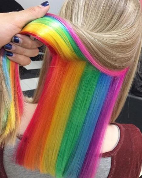 **HIDDEN RAINBOW HAIR**  Pioneered by Shoreditch hair salon Not Another Salon, the hidden rainbow is the ideal way to get your pastel hair on whilst staying safe for work.  Also, it's just the most fun we've ever seen. One moment you're a blonde, the next you're a unicorn. The dream.