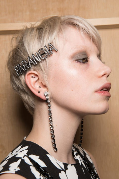 **EXTRA EMBELLISHMENT**  Not just for the office Christmas do, jewelled hair clips are the acccessory du jour.  Do as Ashley Williams AW17 did by wearing one statement clip to the side or fully embrace the trend Toga AW17 style by fixing multiple mismatched jewels all over.  Beauty shoot stylist to the stars Ben Cooke says, 'If you're going to try the multi-jewelled hair clip trend, you need a good amount of texture in your hair so they don't slip and slide and fall out.  This is better done on hair that's slightly dirty. Add some dry shampoo at the root—I love Aussie Miracle Dry Shampoo Mega Instant. Then randomly tong your mid lengths and a few ends to create the texture.  Then, using your fingers, roughly mess it up. Quickly your hair pull up into a loose ponytail and half pull it through to achieve a messy bun.  Then place your clips wherever you like, just remember you don't need to see them all when you look front on in the mirror.'