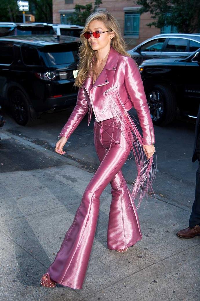 Gigi Hadid steps out in New York City wearing head-to-toe rosé and, of course, we're obsessed with the whole damn thing.
