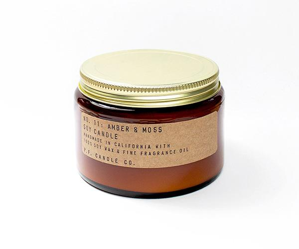 Amber & Moss - P.F. Candle Co Candle, $38, at [The Candle Library](https://thecandlelibrary.com/collections/autumn-2017/products/amber-moss).