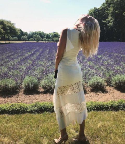 **KARLIE KLOSS** <br></br> Karlie relaxed in the sun during a trip to Château de Wideville with her fashion BFF Derek Blasberg following Haute Couture Fashion Week in Paris.