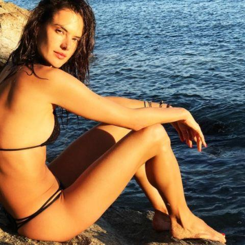 **ALESSANDRA AMBROSIO** <br></br> Alessandra hit Mykonos in Greece (she goes there a lot, FYI) and posted this laid-back snap of her by the sea.