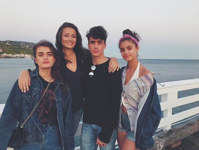 **Taylor Hill** with her sisters, **Mackinley** and **Logan**, and brother, **Chase**.
