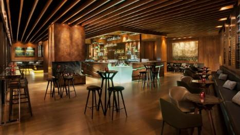 **Grain Bar** <br> <br> Located at the bottom of the Four Seasons hotel, Grain Bar whips up, arguably, the best Hot Toddy in the city. Sink into the evening with a warm sips of this, and pair it with one of their extravagant 'bar snacks', including a cheese fondue.