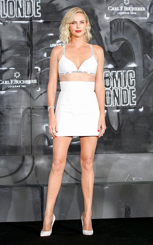 Charlize Theron steps out at the *Atomic Blonde* premiere looking exactly the part, wearing sexy Dior co-ords, finished with a swipe of fire red lipstick.