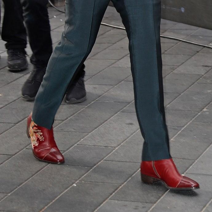 These Gucci dragon appliqué boots.