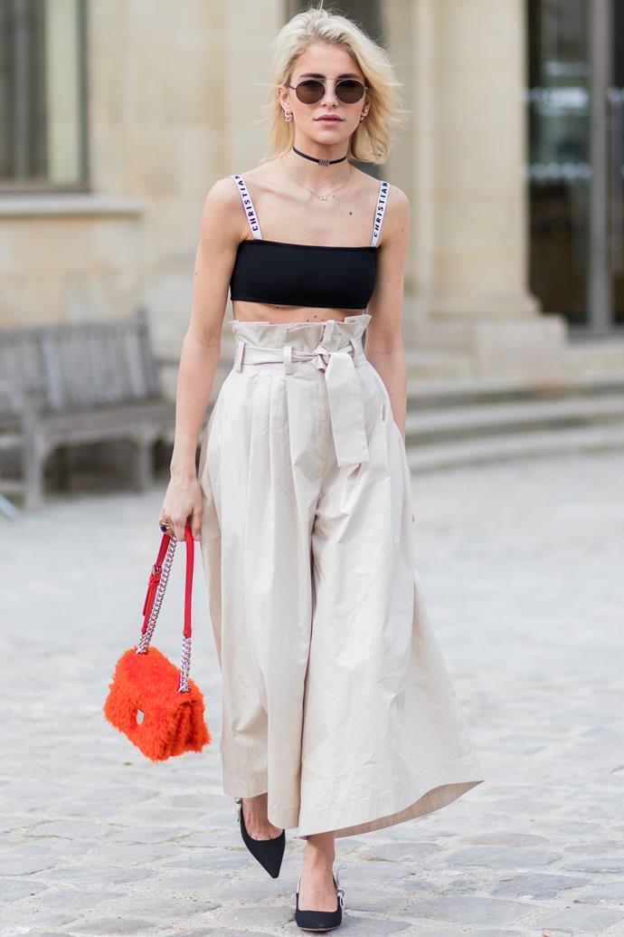 **Caroline Duar**, worn as a crop top with high-waisted pants.