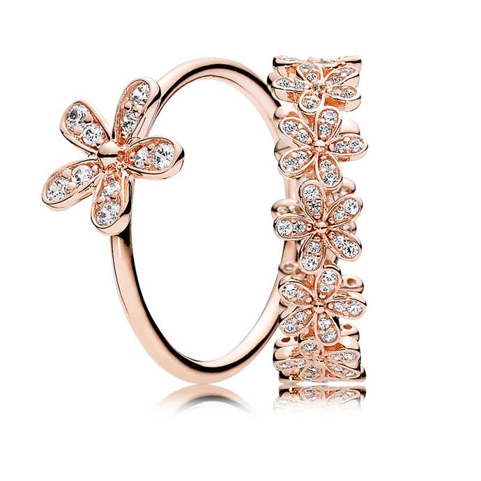 Rose Dazzling Daisy ring stack, $208, [PANDORA](https://ad.doubleclick.net/ddm/clk/402849312;203018969;g)