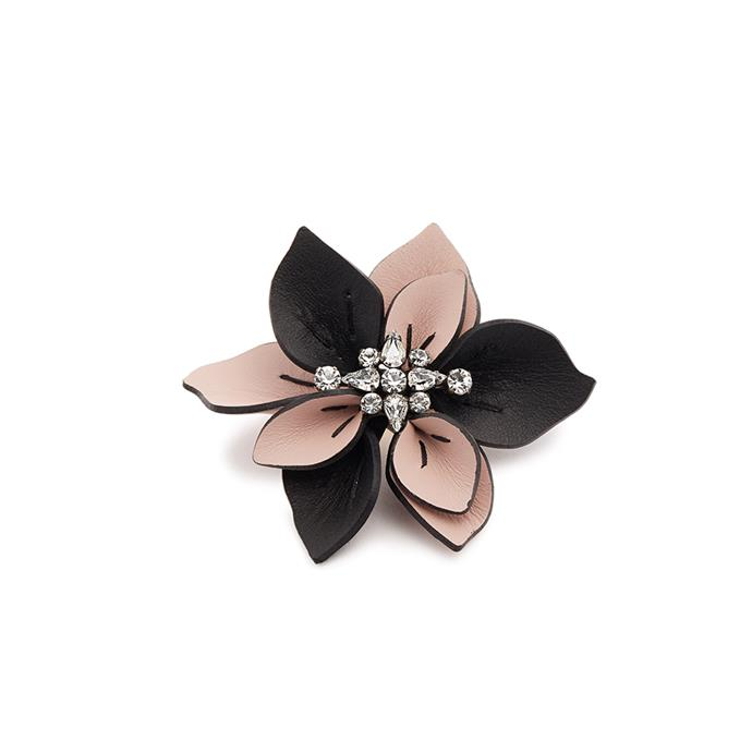 Brooch, $305, [Marni at Matches Fashion](http://www.matchesfashion.com/au/products/Marni-Crystal-embellished-flower-leather-brooch--1162312)
