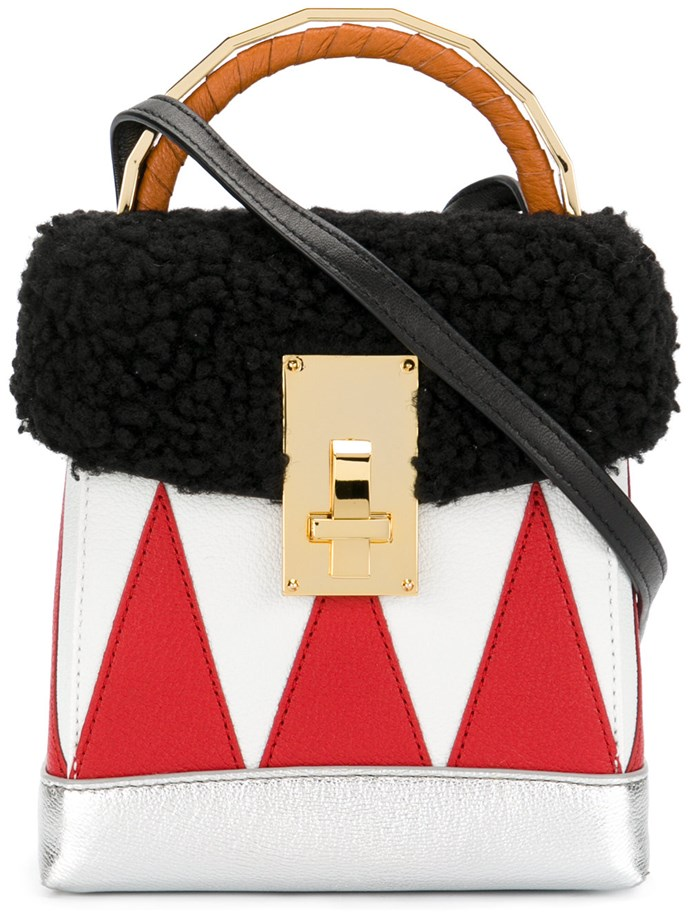"**Buy**: The Volon bag, $1,136 at [Farfetch](https://www.farfetch.com/shopping/women/the-volon-small-boxy-tote-item-12270161.aspx?storeid=9728&from=listing&tglmdl=1|target=""_blank"")"