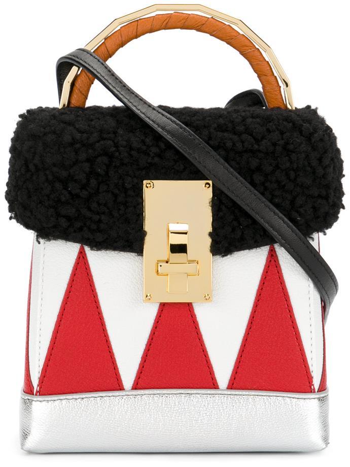 "**Buy**: The Volon bag, $1,136 at [Farfetch](https://www.farfetch.com/shopping/women/the-volon-small-boxy-tote-item-12270161.aspx?storeid=9728&from=listing&tglmdl=1|target=""_blank"")"