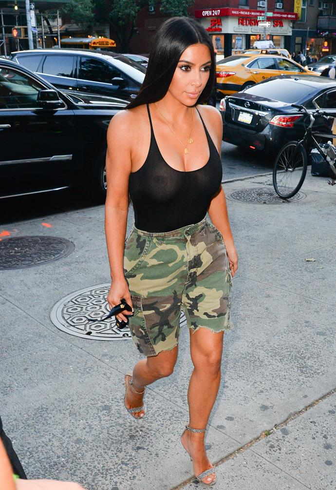 Kim Kardashian steps out in New York City with a new take on the cargo pants style, cutting her pants above the knee to create a pair Bermuda shorts.