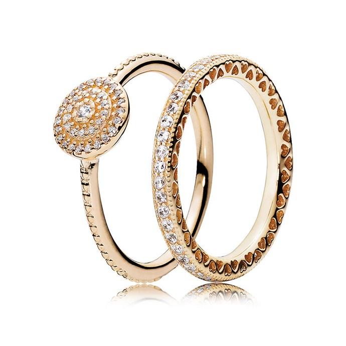 Radiant Elegance Gold ring stack, $798, [PANDORA](https://ad.doubleclick.net/ddm/clk/402852816;203018969;j)