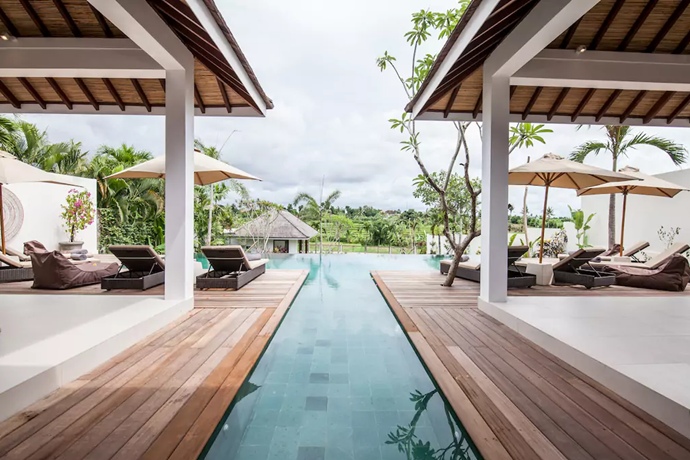 **[Canggu Villa, Mengwi](https://www.airbnb.com.au/rooms/16725166?guests=9&adults=9&children=0&infants=0&s=GurZMzix), Bali** <br> <br> **$378 per night, sleeps 6 guests** <br> <br> This brand new private villa has six bedrooms and six bathrooms along with multiple chill-out spaces that open onto the pool, overlooking the rice fields. You won't want to leave the house.