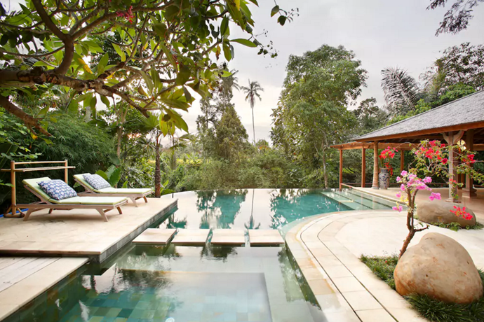 **[Villa Aalaya, Ubud](https://www.airbnb.com.au/rooms/611590?s=UaLf48j3), Bali** <br> <br> **$520 per night, sleeps 8 guests** <br> <br> This beautiful, homey villa, surrounded by lush forest and rice fields, is made up of three antique teak buildings, featuring four bedrooms and four bathrooms—the perfect spot for a family getaway.