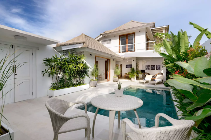 **[Villa Jasmine, Sanur](https://www.airbnb.com.au/rooms/16800599?guests=4&adults=2&children=2&location=Denpasar%20Selatan%2C%20Indonesia&s=Wo9d5a1R), Bali** <br> <br> **$200 a night, sleeps 4 guests** <br> <br> Two bedrooms and two bathrooms  make this modern villa the ideal chic spot for a couple's holiday.
