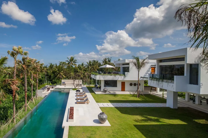 **[The Palm House](https://www.airbnb.com.au/rooms/15088699?guests=2&adults=1&children=1&location=Bali%2C%20Indonesia&s=GDePtvI7), Bali** <br> <br> **$1,405 per night, sleeps 12 guests** <br> <br> Settle in here for a long, retreat-style stay.  Do laps in the 40 metre pool, have a  personal trainer come to the house, and entertain for friends.