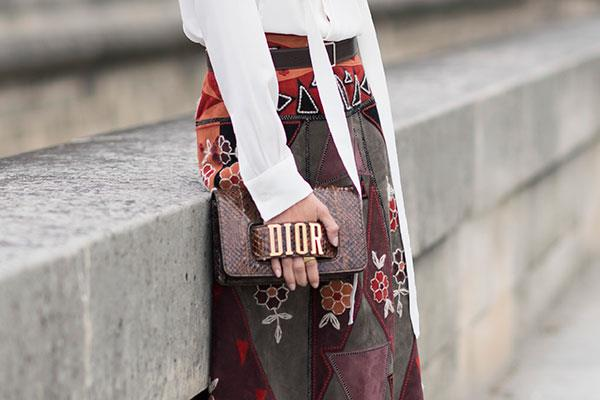 **Sagittarius: Dior's Hand Strap Clutch ** <br><br> Your naturally extroverted, loud and charismatic personality is reflected in your love for statement fashion pieces, Sagittarius. Dior's logo-stamped hand strap clutch is equal parts bold and unapologetic, matching you to a tee.