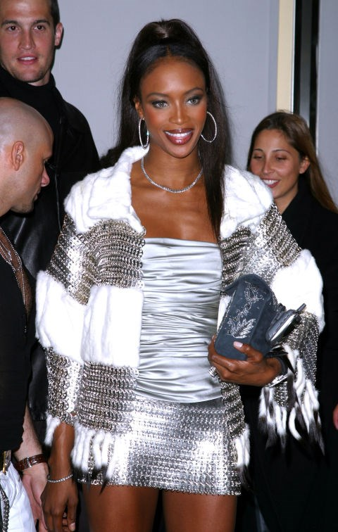 **NAOMI CAMPBELL**  Please let's make phones as purse accessories a thing again.