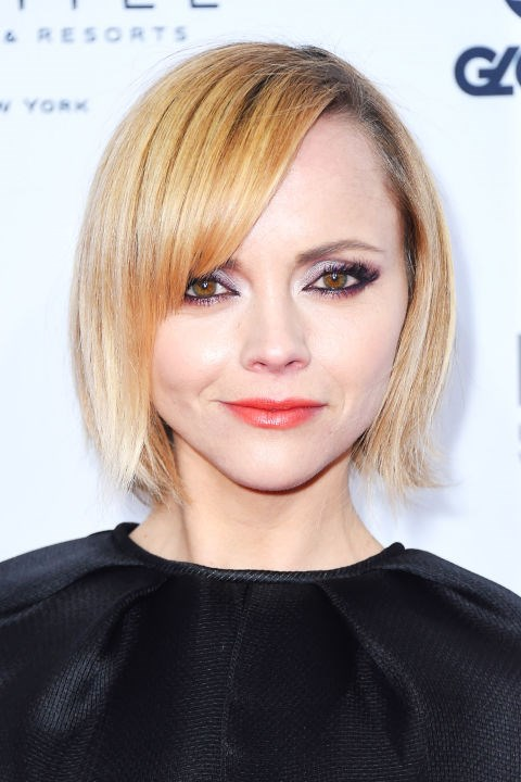 **CHRISTINA RICCI** <br><br> To balance out a round face shape like Christina's, side bangs and a short bob work together to elongate.
