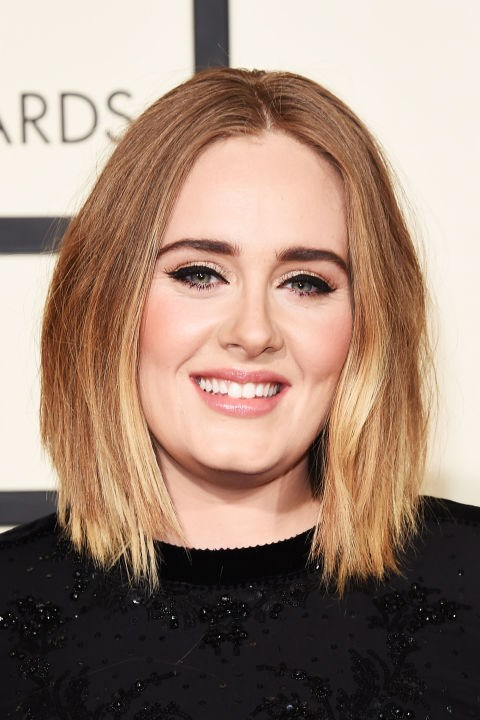 "**ADELE** <br><br> Many round-faced celebs wear their hair with a middle part because it helps elongate your face. [Adele](http://www.elle.com.au/beauty/adele-eyeliner-tutorial-7590|target=""_blank"") wears hers in a blunt bob, and the kinks in her style work to accentuate her cheekbones."