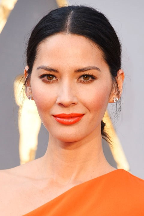 **OLIVIA MUNN** <br><br> Try a clean updo, but don't slick your hair down. Olivia's casual updo leaves the sideburns out, which creates a shadow over the sides of her face. This illusion slims down her face into an oval shape.
