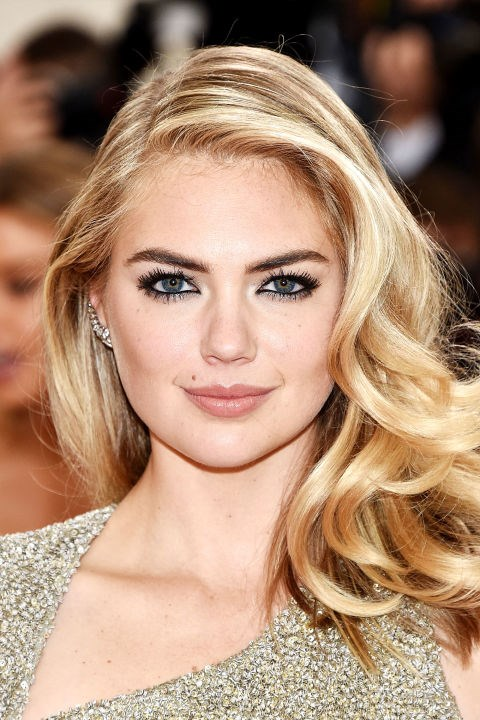 **KATE UPTON** <br><br> Go classic like Kate with Veronica Lake waves and a deep part. Voluminous curls complement a round face.