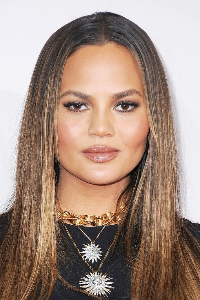 "**CHRISSY TEIGEN** <br><br> Sleek centre-parted hair like [Chrissys](http://www.elle.com.au/news/chrissy-teigen-elle-australia-cover-shoot-video-6779|target=""_blank"") accentuates high cheekbones and cuts the width of the face."