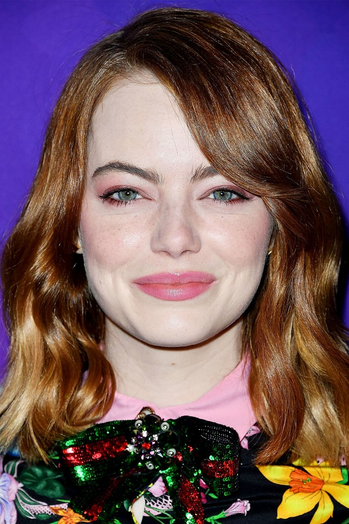"**EMMA STONE** <br><br> [Emma's](http://www.elle.com.au/celebrity/emma-stone-responds-to-prom-invite-5660|target=""_blank"") swooping bangs and soft waves complement her face shape."