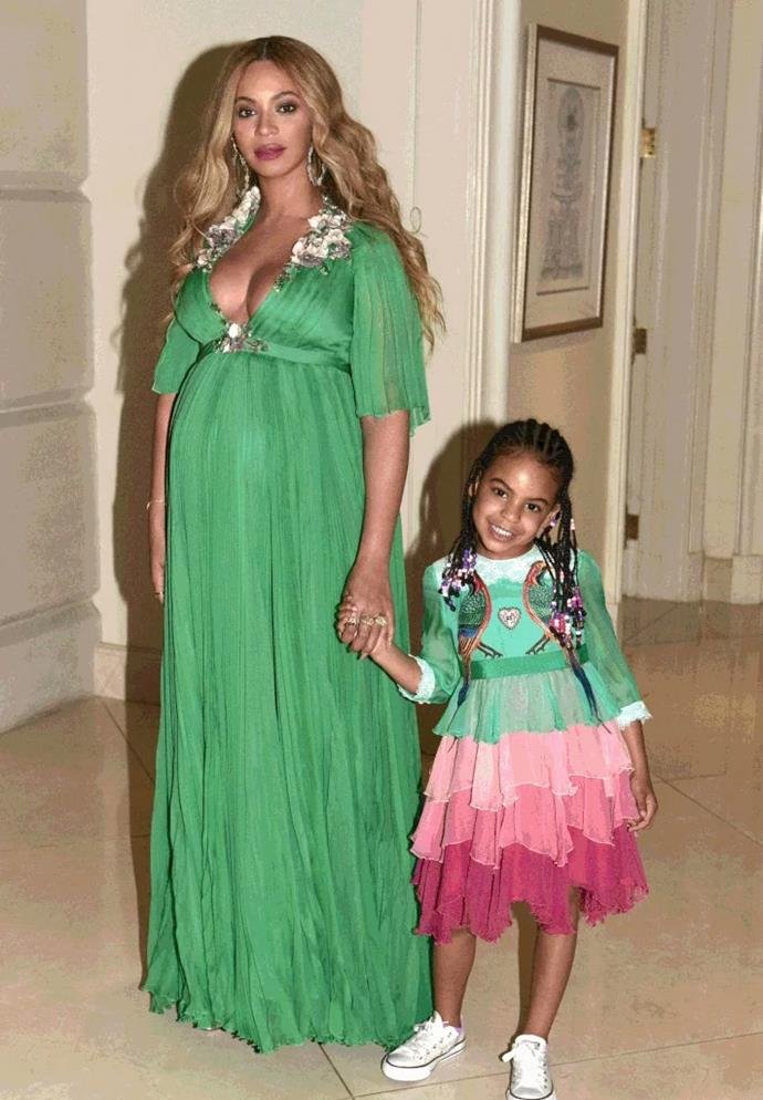 Beyoncé wore an emerald green chiffon Gucci dress to the premiere of *Beauty and the Beast*. Blue, meanwhile, wore a mini, modified version of the [velvet-trimmed embellished tiered silk-chiffon gown](https://www.net-a-porter.com/us/en/product/757433/Gucci/velvet-trimmed-embellished-tiered-silk-chiffon-gown?cm_mmc=LinkshareUK-_-TnL5HPStwNw-_-LinkshareUS-_-TnL5HPStwNw-_-Custom-_-LinkBuilder&siteID=TnL5HPStwNw-uO0RVbQz5UtPqhrjznvVcw&Skimlinks.com=Skimlinks.com&siteID=TnL5HPStwNw-12j4cv9Dwyxp8QoiNjt6QA&Skimlinks.com=Skimlinks.com), which retails for $26,000 USD.