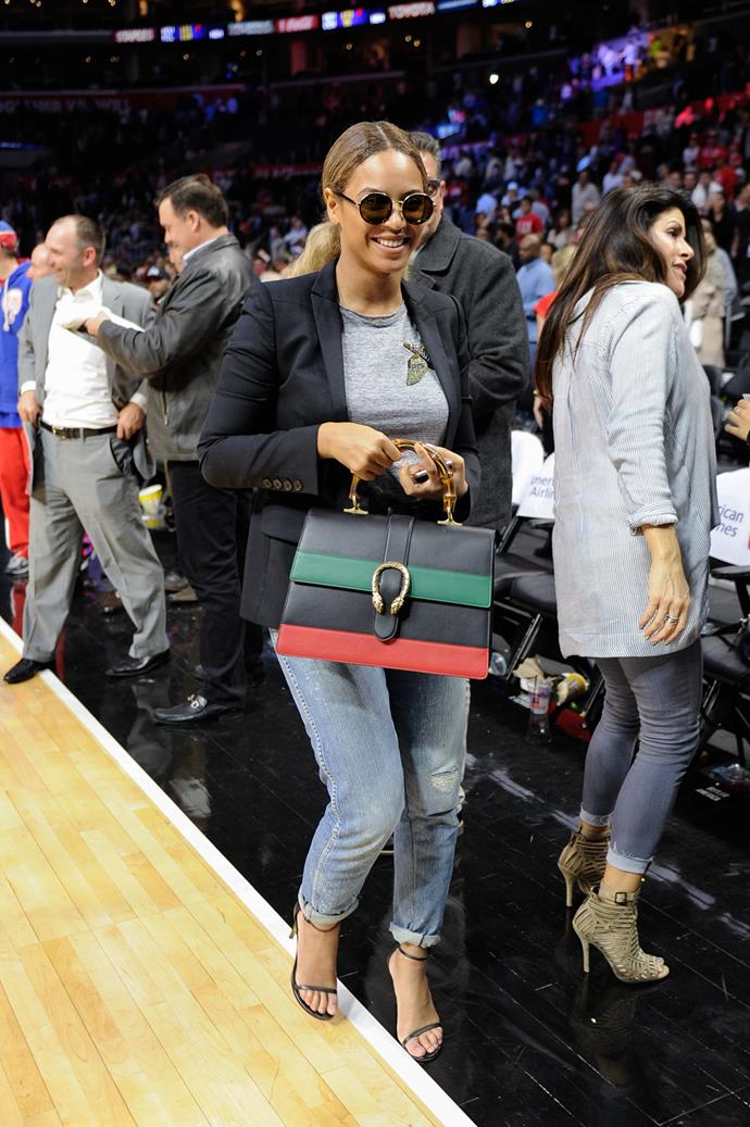 Beyoncé's Dionysus bag was front and centre at a basketball game. She also wore the embellished bird tee.