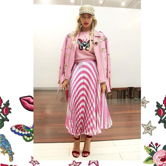 Pretty in pink! Beyoncé's outfit was [top-to-toe](http://fashionbombdaily.com/get-the-look-beyonces-new-york-city-gucci-gg-logo-cap-1200-pink-intarsia-merino-wool-knit-butterfly-sweater-2200-pleated-metallic-striped-stretch-silk-midi-skirt-750-lips-embellished-gg-supre/) Gucci.
