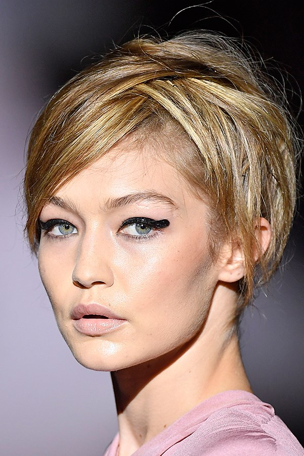 **Tom Ford:** Park your precision eyeliner, this season pointy-tipped wings have been replaced by faff-free rounded edges—seen here topped with glitter—that require less accuracy. And less mirror time. Hallelujah.