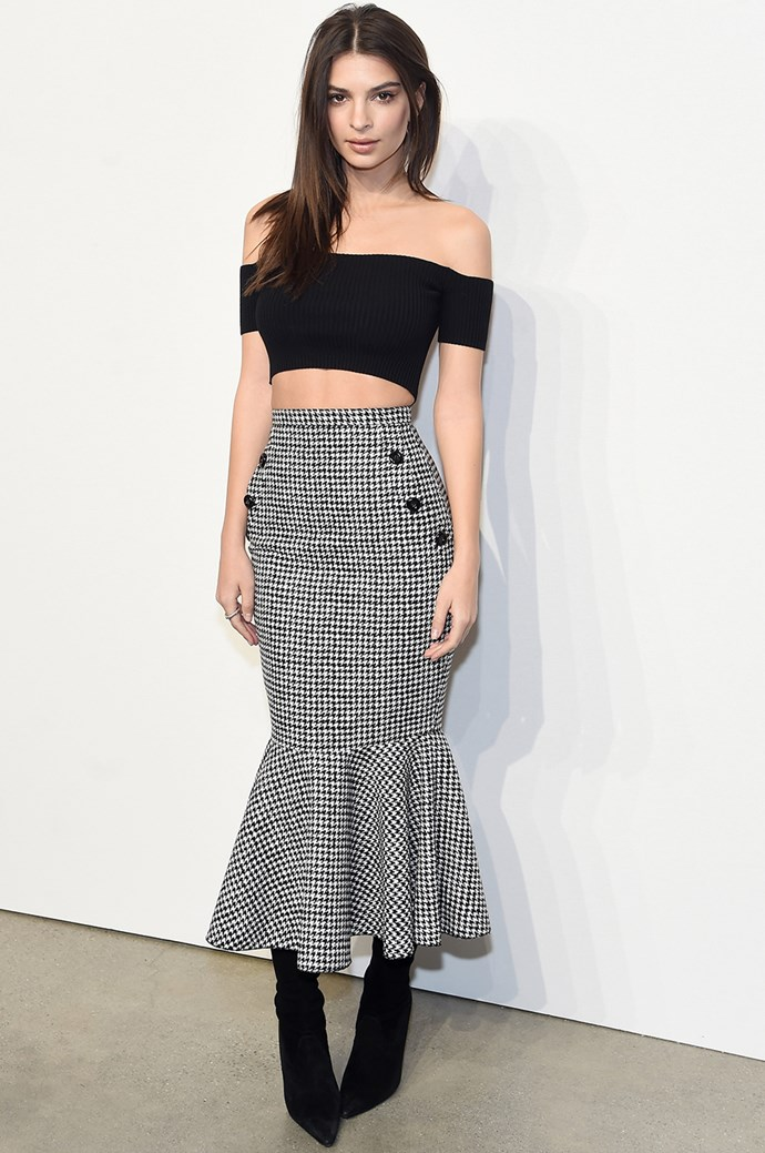 **Emily Ratajowski:** Let's be real, Em Rata could look smokin' in a garbage bag, but her it's her low-key sexy style we rate the most—like this midriff-flashing off-the-shoulder top paired with a fishtail hem midi-skirt.