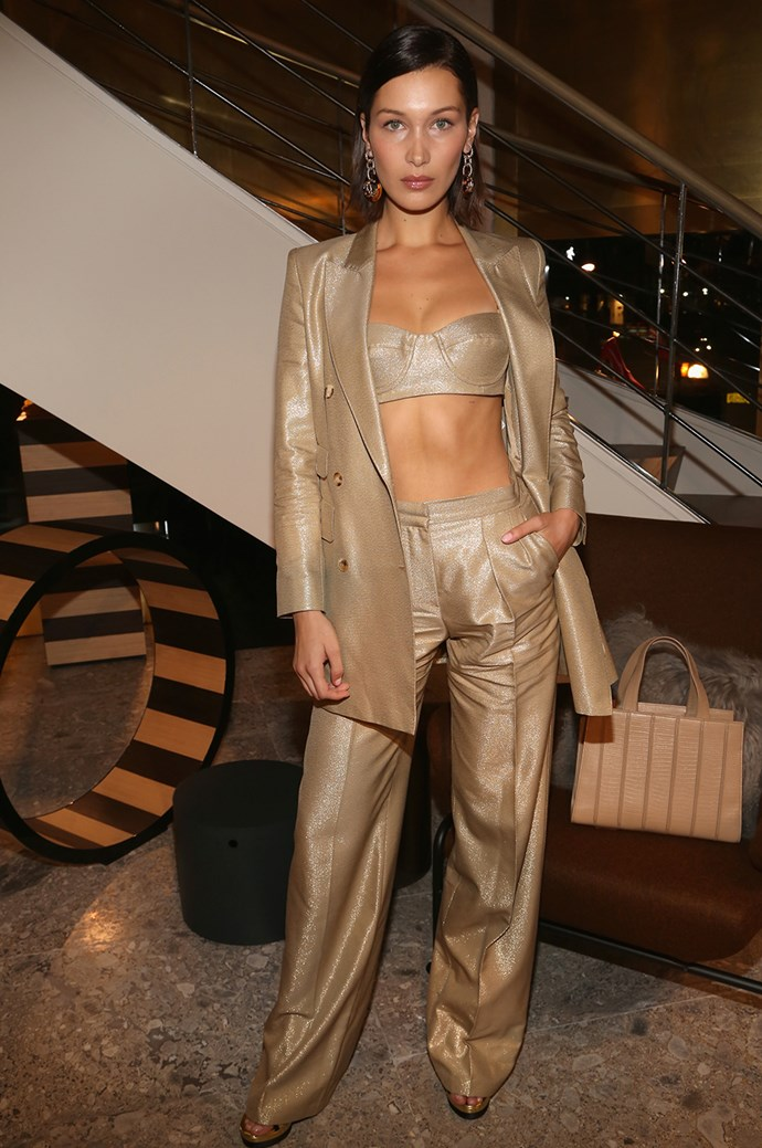 **Bella Hadid:** What's alluring? Power. And what's more powerful (or sexy, for that matter) than a shimmering champagne gold three-piece trouser suit? We'll wait.