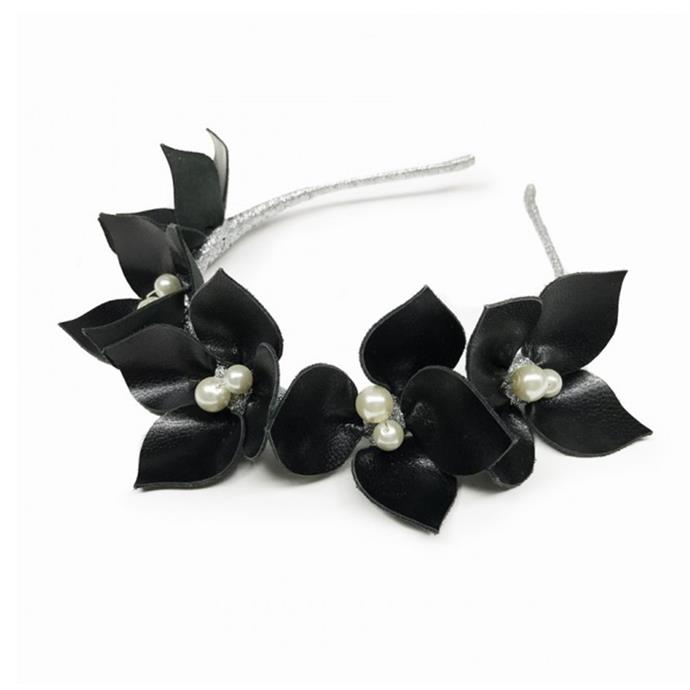Try florals, bows or headscarves for a modern take on trackside style. Headband, $895, [Viktoria Novak](https://viktorianovak.com.au/collections/available-now-18/queenie-black-pearl.html)