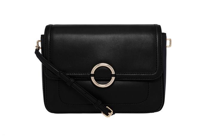 Bag, $267 at [Oroton](https://www.oroton.com.au/ashbury-medium-clutch-black) <br><Br> **Compartments:** Three, plus two interior zip pockets and one slip pocket.