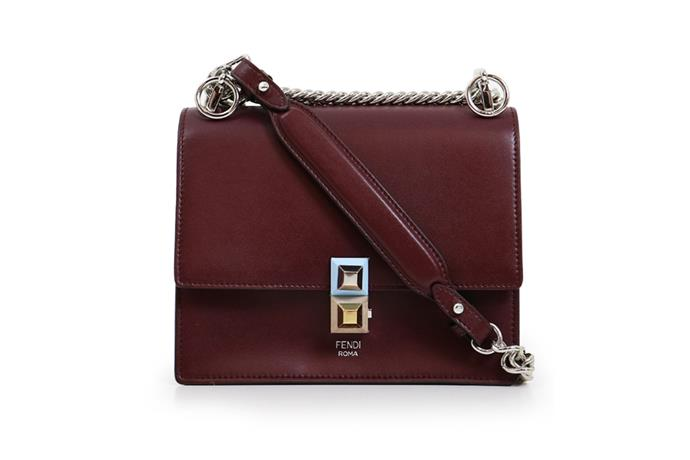 Bag, $2,285, Fendi at [Parlour X](https://www.parlourx.com/brands/fendi/kan-i-bag-bordeaux.html) <br><Br> **Compartments:** Two, plus a card slot.