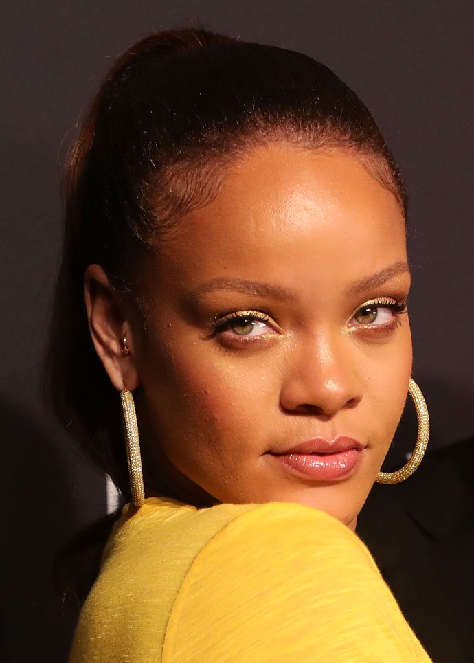 The singer was literally glowing at the event with a face full of Fenty.