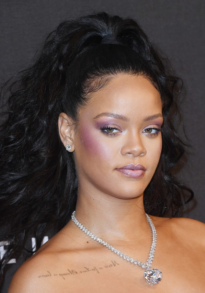 Rihanna's makeup matched her dress as she went with a purpley-pink highlighter and glossy lip.