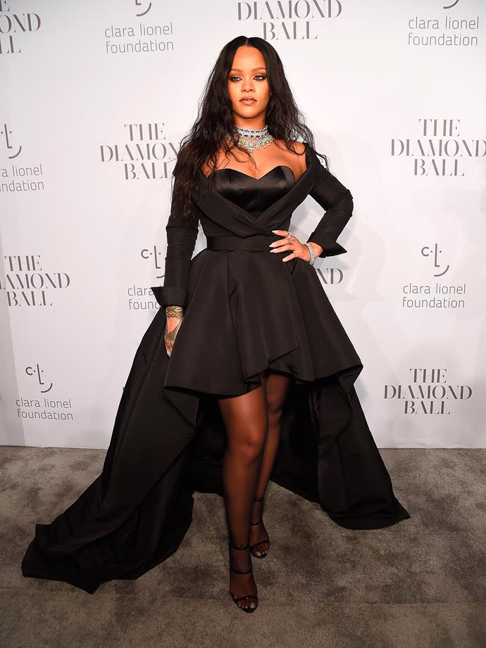 Taking a small break from her Fenty Beauty tour, Rihanna attends the Diamond Ball in New York City—wearing a dramatic black dress.