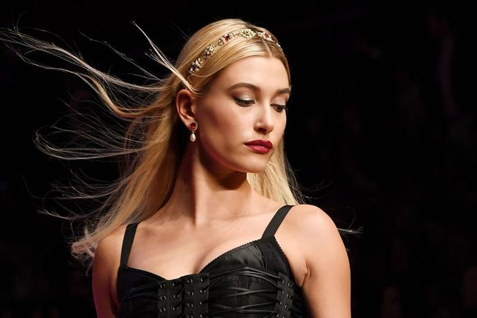 **Hailey Baldwin** <br> <br> This Queen Bee of the influencer set was the second model to walk the Dolce & Gabbana catwalk, and she turned the runway's wind machine into her own personal hair fantasy. Way to show 'em how it's done…