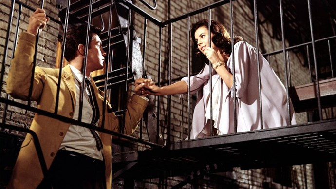 **Richard Beymer and Natalie Wood in *West Side Story*** <br><br> The 1961 musical *West Side Story*, which was based on the Broadway musical of the same name, re-interpreted *Romeo and Juliet* as a rivalry between two gangs in 1957 New York: the Jets (the white gang) and the Sharks (the Puerto Rican gang). Natalie Wood starred as Maria, the younger sister of Sharks leader Bernardo, while Richard Beymer played Tony, the co-founder of the Jets, who fell in love with Maria.