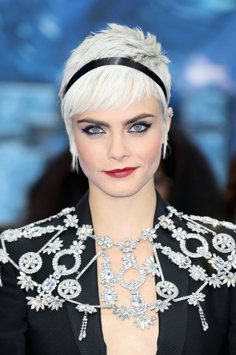 CARA DELEVINGNE WITH A PIXIE CUT AND RIBBON